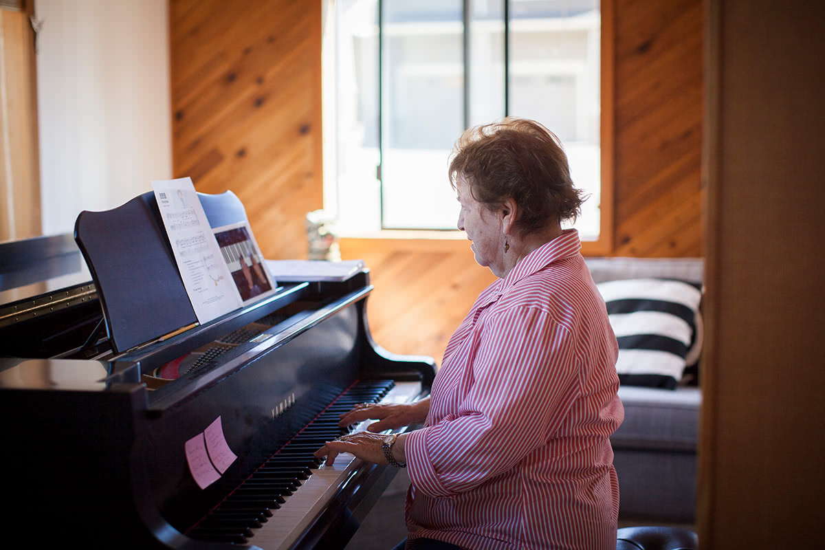 Adult Woman Learning Piano