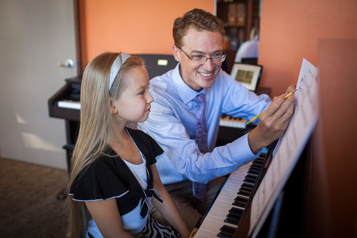 Young Girl Taking Piano Lesson